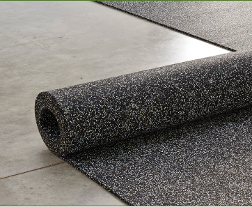 Unrolling a roll of 20% Gray and 80% Black Tire Veneer resilient flooring, 4 foot wide x 1/4 inch thick over a concrete floor.