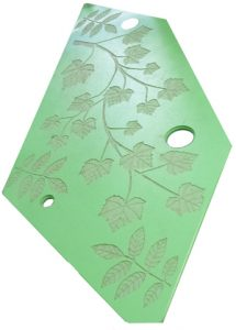 Laser Etching of leaves on green Origins panel